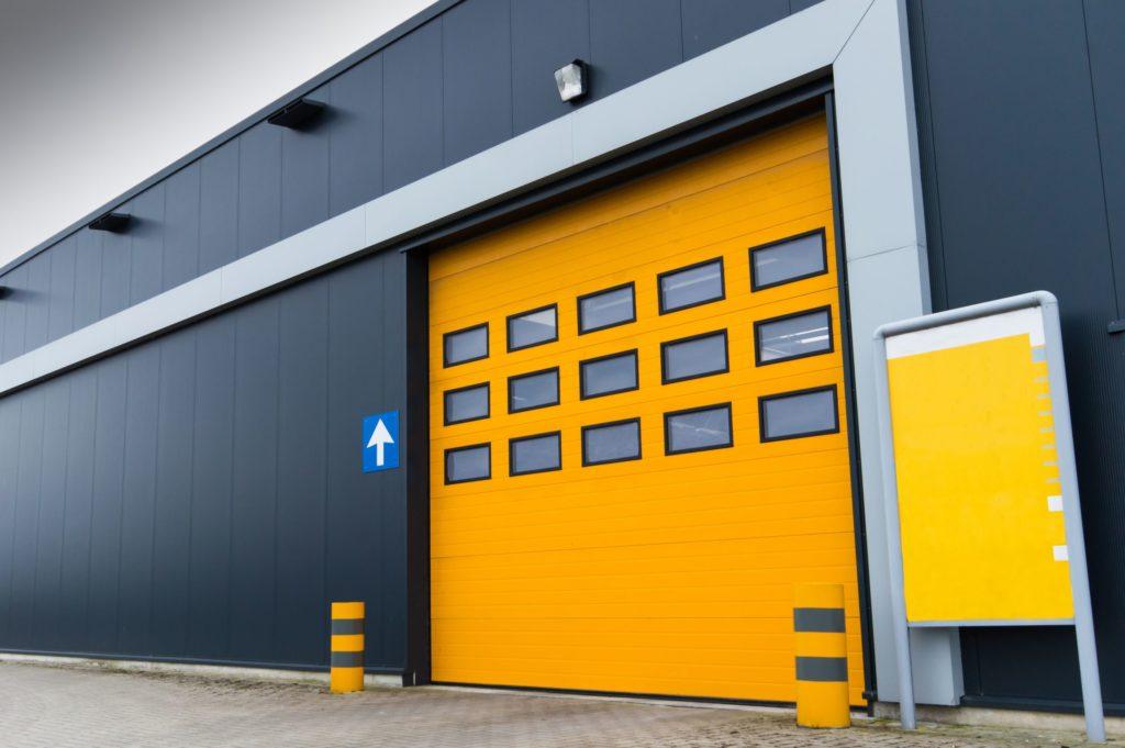 18847394 - yellow loading door in a storage building